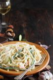 Lunguini shrimps and zucchini with cream. Close up royalty free stock image