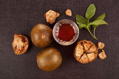 Luo Han Guo aka Monk fruit. Natural remedy on black background. Powerful healthy sweetener royalty free stock images