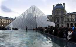 Luovre Museum building with glass Pyramid, Paris, France royalty free stock photography
