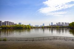 Luoyang city sui tang ruins park lake and the municipal government buildings and the surrounding buildings. Luoyang city sui and tang dynasty ruins park lake and stock images