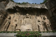 Longmen Grottoes in Luoyang. Lu She Na Buddha carving in the Longmen Grottoes in Luoyang, China royalty free stock images