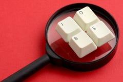 Lupa blanca de las llaves de teclado de los trabajos Fotos de archivo