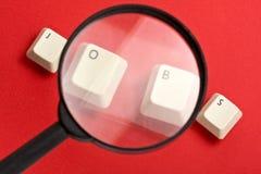 Lupa blanca de las llaves de teclado de los trabajos Imágenes de archivo libres de regalías