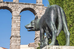 Lupa Capitolina statue at the foot of Aqueduct of Segovia Royalty Free Stock Photography