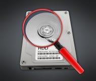Lupa en la unidad de disco duro Fotografía de archivo libre de regalías