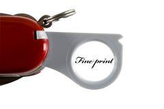Lupa en un cuchillo de bolsillo Foto de archivo libre de regalías