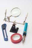 Lupa, gazu lutowniczy żelazo, skalpel i izolowanie taśma, Fotografia Royalty Free