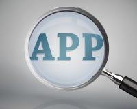 Lupa que mostra a palavra do app Imagens de Stock
