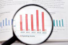 Lupa y estadística Imagen de archivo libre de regalías