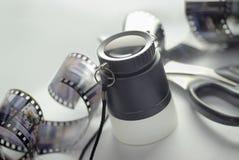 Lupa y película Fotografía de archivo libre de regalías