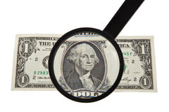 Lupa y un dólar Fotos de archivo