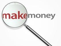 lupe挣在文本的金属货币 免版税库存图片