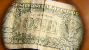 Lupe auf den alten Amerikaner-Dollar stock video footage