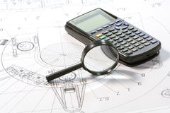 Lupe with plan und calculator. Black lupe with architectural plan und calculator Royalty Free Stock Photos