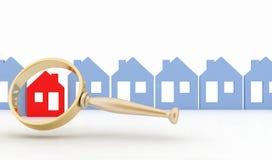 Lupe wählt vor oder kontrolliert ein Haus in Folge von Häusern Lizenzfreie Stockfotos