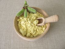 Lupin flour in wooden bowl Stock Images