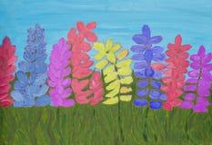 Lupinen von verschiedenen Farben, malend Stockfotografie