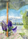 Lupines and umbrella Royalty Free Stock Images