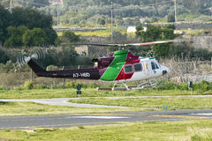Luqa, Malta 2 April 2015: Gulf Helicopters Bell 412EP taxi back to base. Royalty Free Stock Photography