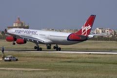 Luqa, Malta, 21 April 2008: Virgin A340 landing. Virgin Atlantic Airways Airbus A340-313 landing in Malta after declaring a medical emergency on board Royalty Free Stock Image