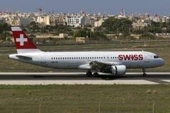 Luqa, Malta 30 August, 2015: Swiss A320 landing. Swiss International Air Lines Airbus A320-214 landing runway 31 Royalty Free Stock Photos