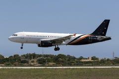 Luqa, Malta 18 August, 2015: Titan A320 landing.. Titan Airways Airbus A320-233 landing runway 31, operating a British Airways flight Stock Photo
