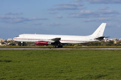 Luqa, Malta - 20 February 2009: Classic DC-8 landing. Royalty Free Stock Photography