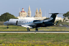 Luqa, Malta 12 January 2016: Embraer on finals. Royalty Free Stock Photos
