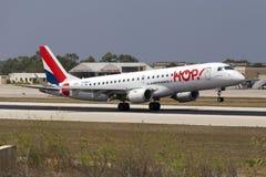 Luqa, Malta 11 July 2015: Hop! ERJ-190 landing. Hop (Air France) Embraer 190LR (ERJ-190-100LR) is seen landing runway 13 Stock Photos