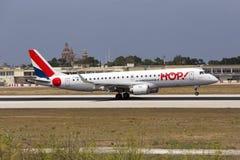 Luqa, Malta 11 July 2015: Hop! ERJ-190 landing. Hop (Air France) Embraer 190LR (ERJ-190-100LR) is seen landing runway 13 Stock Photography