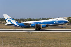 Luqa, Malta, 18 July 2015: Jumbojet landing 31. AirBridgeCargo Airlines Boeing 747-8HVF/SCD arriving after a long flight from Toronto. This is a freight Royalty Free Stock Images