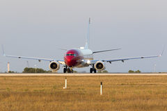 Luqa, Malta 8 July 2015: Norwegian 737 on the runway. Norwegian Air Shuttle Boeing 737-8JP departing back to Oslo in the late evening warm light Stock Photo