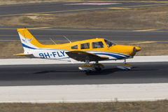 Luqa, Malta, 19 July 2015: Piper PA-28-161 Warrior II. Sky People Piper PA-28-161 Warrior II landing runway 31, performing pilot lessons Stock Photography