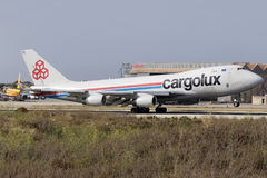 Luqa, Malta 24 June 2015: Cargo plane 747 landing. A Cargolux Boeing 747-400 landing runway 13 in the mid afternoon. The 747 is the original Jumbo jet and first Stock Photography