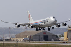 Luqa, Malta 24 June 2015: Cargo plane 747 landing. A Cargolux Boeing 747-400 landing runway 13 in the mid afternoon. The 747 is the original Jumbo jet and first Royalty Free Stock Photo