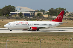 Luqa, Malta - 7 June 2005: Jumbojet landing. Islandsflug Boeing 737-4S3 entering runway 31 for take off Stock Photos