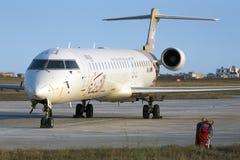 Luqa, Malta 30 June 2015: Libyan CRJ-900ER in park 4. Stock Image