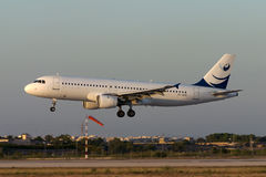 Luqa, Malta 29 June 2005: Sunset A320 landing. Stock Photos