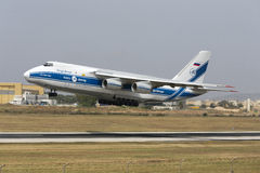 Luqa, Malta 13 June 2015:  Volga-Dnepr Airlines Antonov An-124-100 Ruslan takes off from runway 13. Royalty Free Stock Photo