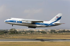 Luqa, Malta 13 June 2015:  Volga-Dnepr Airlines Antonov An-124-100 Ruslan takes off from runway 13. Stock Photography