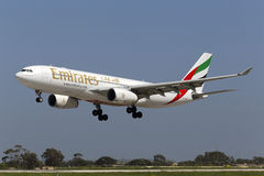 Luqa, Malta 25 March 2015: Emirates A330-243 on finals runway 31. Royalty Free Stock Photos