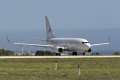 Luqa, Malta - 8 October 2015: Chinese 737 BBJ. Deer Jet Boeing 737-73W BBJ [B-2573] taxiing out for take off from runway 31 on a still very hot afternoon in royalty free stock images