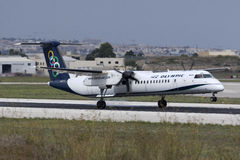 Luqa, Malta 3 October 2015: Olympic Airlines Dash 8 landing. Greek Dash 8 [SX-OBA] on short finals runway 13 Stock Images