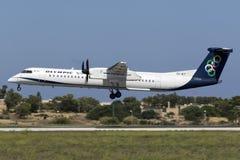 Luqa Malta - 10 September 2015: OS DHC-8 Arkivbild