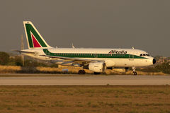 Luqa, Malta 30 September 2005: A319 in the sunset. Royalty Free Stock Images