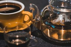 Luqiud Filled Clear Glass Teapot With Cup stock images