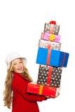 Lura flickan som rymmer många gåvor staplade på henne handen Arkivfoton