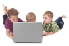 lurar bärbar dator tre royaltyfria bilder