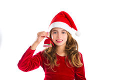 Lurar den röda klockakakan för jul och Xmas-klänningen flickan Arkivfoto