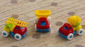 Lurar leksakbilar Arkivbilder